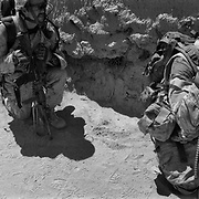 Canadian Infantry from the Royal Canadian Regiment (RCR) take cover behind a mud wall after an improvised explosive device (IED) blast ahead of them while on a clearing operation in the Sperwan area of voltile Panjwaii District in Kandahar, Afghanistan. Canadian Forces have been conducting a bloody counterinsurgency campaign in this region since 2006 when the insurgency made it's return to the region.(Credit Image: © Louie Palu/ZUMA Press/The Alexia Foundation)
