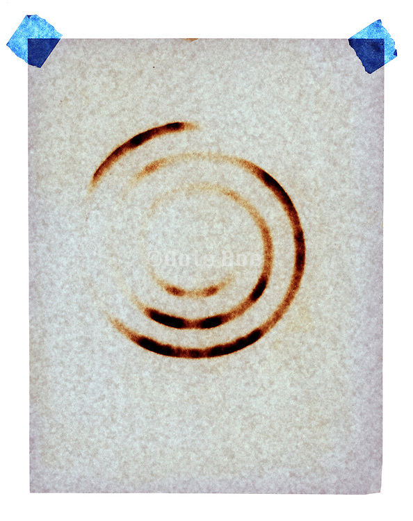 sheet of white paper burned with a circular imprint