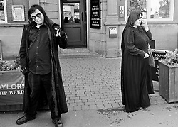 © Licensed to London News Pictures.01/11/15<br /> Whitby, UK. <br /> <br /> A goth poses for a picture as hundreds of visitors attend the Whitby Goth weekend in Whitby, North Yorkshire. The event began in 1994 to celebrate goth culture and music and takes place twice each year. <br /> Thousands of extravagantly dressed people attend the popular event wearing Steampunk, Cybergoth, Romanticism, Victoriana and other clothing as they take part in the celebration of Goth culture. <br /> <br /> Note to Editors - Picture shot on Kodak Tri X 400ISO film.<br /> Photo credit : Ian Forsyth/LNP