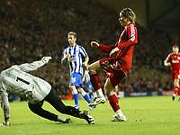Photo: Paul Greenwood/Sportsbeat Images.<br />Liverpool v Porto. UEFA Champions League. 28/11/2007.<br />Liverpools Fernando Torres scores past Porto keeper Helton