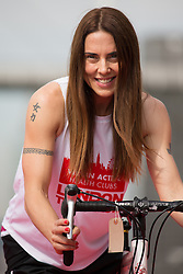 © Licensed to London News Pictures. 27/07/2013. London, UK. Melanie C rides a bicycle at the London Triathlon 2013 at the ExCel centre in Royal Victoria Dock in East London. Photo credit : Vickie Flores/LNP