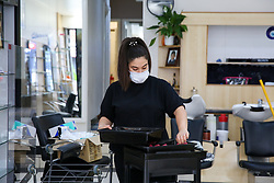 © Licensed to London News Pictures. 30/06/2020. London, UK. Staff in Cheriee on Green Lanes in Harringay, north London, clean the mirrors as Cheriee prepare to reopen on 4 July. Hairdressers across the UK closed on 23 March following the coronavirus lockdown. As coronavirus lockdown restrictions are eased, hairdressers will reopen on Saturday 4 July.  Photo credit: Dinendra Haria/LNP