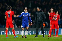 Cesc Fabregas of Chelsea looks dejected as he congrtulates Edinson Cavani of Paris Saint-Germain after the match ended 2-2 (3-3) sending PSG through to the Quarter Finals on away goals - Photo mandatory by-line: Rogan Thomson/JMP - 07966 386802 - 11/03/2015 - SPORT - FOOTBALL - London, England - Stamford Bridge - Chelsea v Paris Saint-Germain - UEFA Champions League Round of 16 Second Leg.