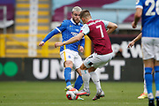 Brighton and Hove Albion forward Aaron Connolly (44) and Jóhann Guðmundsson of Burnley (7)  contest a loose ball  during the Premier League match between Burnley and Brighton and Hove Albion at Turf Moor, Burnley, England on 26 July 2020.