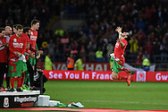 'see you in France' is seen as Gareth Bale of Wales jumps in the air with delight as he celebrates after the match as the Wales team qualify for Euro 2016 finals in France.  Wales v Andorra, Euro 2016 qualifying match at the Cardiff city stadium  in Cardiff, South Wales  on Tuesday 13th October 2015. <br /> pic by  Andrew Orchard, Andrew Orchard sports photography.