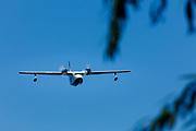 Grumman Albatross flying over seaplane base, Airventure 2017.