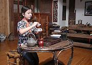 Traditional Chinese tea ceremony at the Mei Jia Wu tea plantation, Hangzhou, China