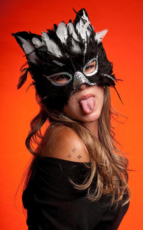 Young caucasian girl wearing a cat mask.
