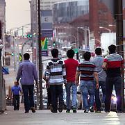 Group of friends on sidewalk along Grand Avenue near 22nd Street, Kansas City, MO.