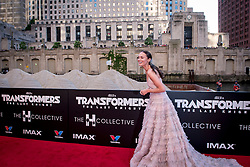 Laura Haddock laughs at a passing barge at the US Premier of 'Transformers: The Last Knight' on the Chicago River in front of the Civic Opera House on Tuesday June 20, 2017 in Chicago, IL. Photo: Christopher Dilts / Sipa USA *** Please Use Credit from Credit Field ***