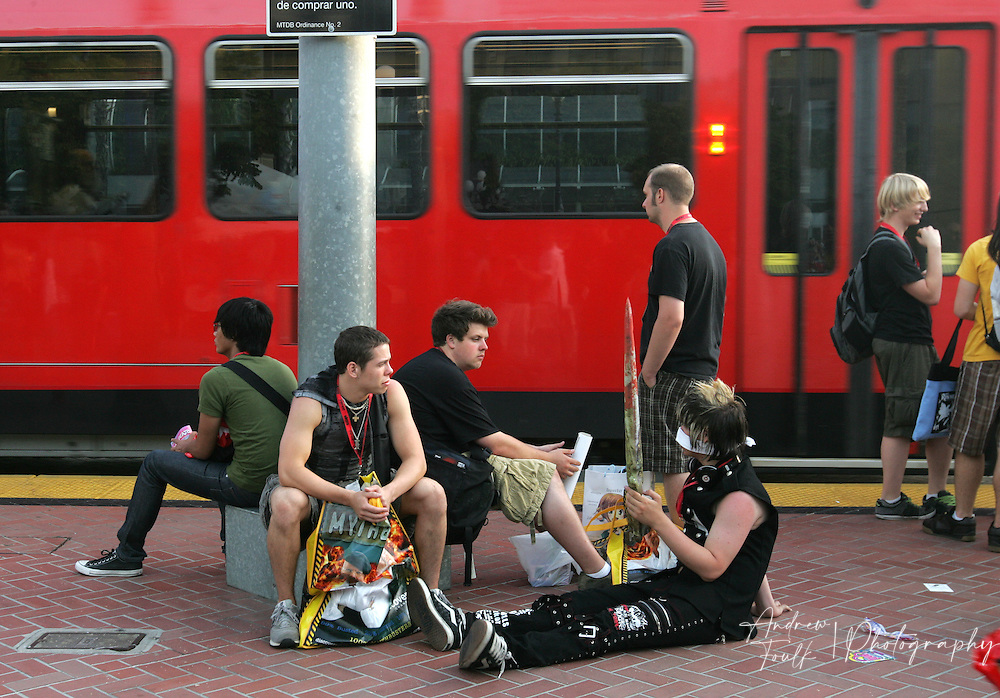 Andrew Foulk/ Zuma Press.July 24, 2009, San Diego, California, USA. Comic Con. Comic Con attendees   wait for their trains, after leaving day two of the 40th annual San Diego International Comic Con.