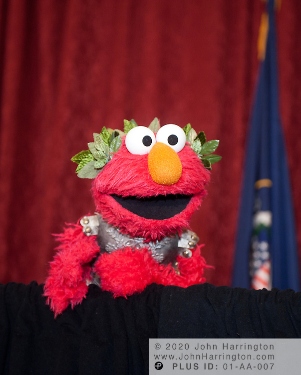 """Elmo, from the children's television show 'Sesame Street', appears at a press conference announcing a new partnership between The National Children's Museum and the Sesame Workshop at the Russell Senate Office Building in Washington, DC on February 3, 2011.  The Sesame Workshop, the organization behind the television show """"Sesame Street"""" will have a permanent home in the nation's capital, a move that will expand the organization's mission of education."""