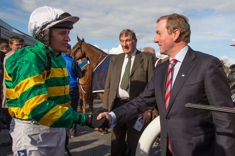 Horse Racing - Fairyhouse Easter Festival, Monday 28th March 2016<br /> An Taoiseach, Enda Kenny greets (Barry Geraghty) the Grand National jockeys as they enter the parade ring<br /> Photo: David Mullen /www.cyberimages.net / 2016