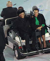July 11, 2010 - Johannesburg, South Africa - South African Former President NELSON MANDELA (L) and his wife GRACA MACHEL, greet the spectators during the closing ceremony of the 2010 FIFA football World Cup ahead of the final between the Netherlands and Spain  at Soccer City stadium in Johannesburg. (Credit Image: © Li Ga/Xinhua/ZUMApress.com)