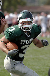 09 September 2006 Titan All American Eric Esch..In the first ever football competition between the Olivet Comets and the Illinois Wesleyan Titans, the Titans strut off the field with a 21- 6 victory. .Game action took place at Wilder Field on the campus of Illinois Wesleyan University in Bloomington Illinois.