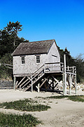 Rustic boathouse on the beach, Chatham, Cape Cod, MA, USA