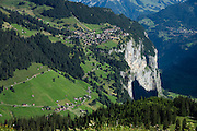 From Tanzbodeli trail base in Upper Lauterbrunnen Valley, see Gimmelwald village (near) and Wengen (far) in Switzerland, Europe. We loved hiking to the quiet retreat of Berghotel Obersteinberg, which offers tremendous views of waterfalls and peaks in Upper Lauterbrunnen Valley. Lit by candle light at night, this romantic escape built in the 1880s recalls an earlier era without power. The main luxuries here are flush toilets down the hall, and traditional Swiss hot meals. The private double rooms lack electricity, and bowls of water serve as bath and sink. Obersteinberg is a 2-hour walk from Stechelberg, or 4 hours from Mürren, in one of the world's most spectacular glaciated valleys. From Obersteinberg, don't miss the 2-3 hours round trip to the deep-blue tarn of Oberhornsee in the upper glacial basin, beneath snowcapped Grosshorn, Breithorn and Tschingelhorn. The Swiss Alps Jungfrau-Aletsch region is honored as a UNESCO World Heritage Site.