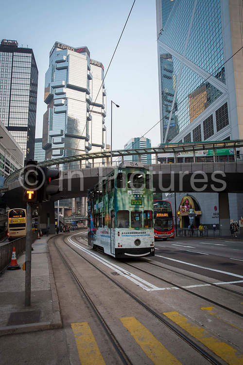 Trams and buses driving on Paterson Street, Hong Kong.