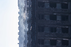 London, June 15th 2017. The Grenfell residential tower block in West London still smoulders following June 14th devastating fire in which 12 people so far are reported to have died, with dozens more injured and many reported missing.