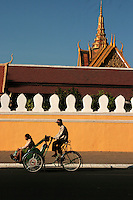 Cyclo Passing the Royal Palace in Phnom Penh - The cycle rickshaw is a small scale means of transport known by a variety of other names such as bike taxi, velotaxi, pedicab, bikecab, cyclo, beca, becak or trishaw. Different from rickshaws pulled by a person on foot, cycle rickshaws are human powered by pedaling. Cycle rickshaws are widely used in South, Southeast and East Asia.