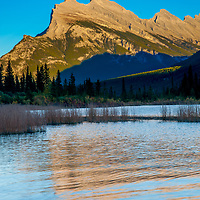 The sun sets over Mount Rundle and Vermillion Lakes in Banff National Park, Alberta, Canada.