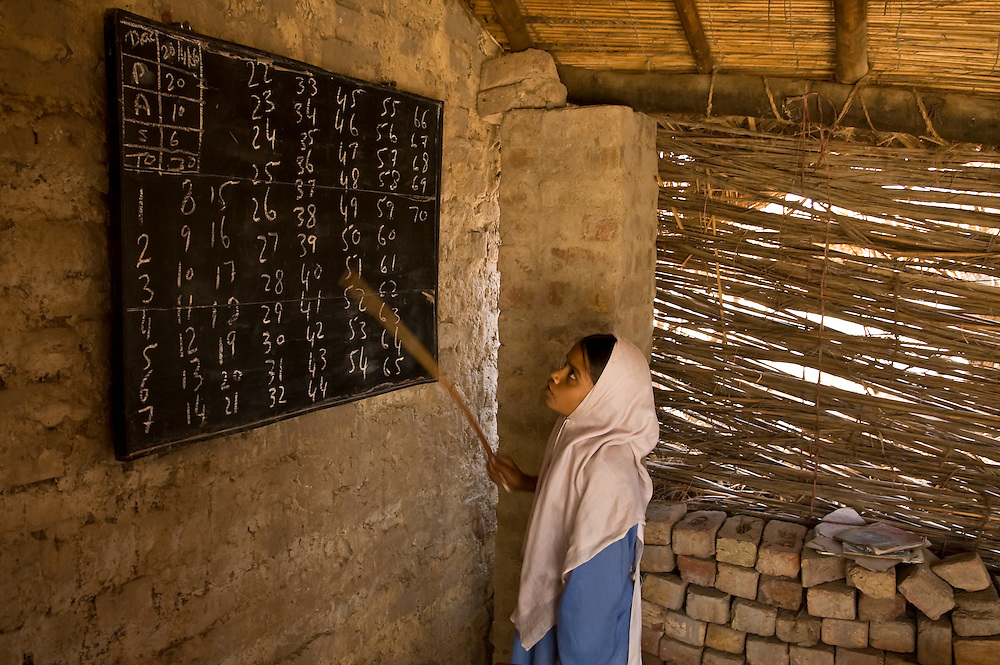 The Sindh region of southern Pakistan is dry and very hot.  It is dotted with remote villages and traditional people.  A village school.