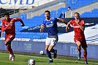 Football - 2020 / 2021 EFL Sky Bet Championship - Cardiff City vs Reading<br /> <br /> Kieffer Moore of Cardiff City on the attack, Josh Laurent  & Michael Morrison of Reading defends      , at the Cardiff City Stadium.
