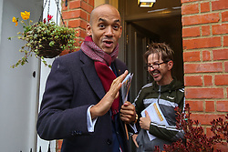 © Licensed to London News Pictures. 25/11/2019. Watford,  Hertfordshire UK. Liberal Democrat Foreign Affairs Spokesman and candidate of Cities of London & Westminster, CHUKA UMUNNA speaks with a resident during national canvassing in Watford. Britons go to the polls on 12 December in a General Election.Photo credit: Dinendra Haria/LNP