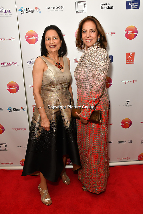 Minu Bakshi (R) is a UKAFF Charwoman attends the UK Asian Film Festival closing flame awards gala - Red Carpet at BAFTA 195 Piccadilly, on 7 April 2019, London, UK