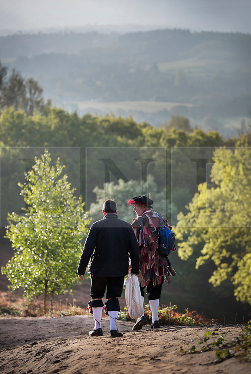 © Licensed to London News Pictures. 01/05/2017. Albury, UK. Two of The Pilgrim Morris Men of Guildford head home on the South Downs Way after performing on St Martha's Hill at dawn on May Day. Photo credit: Peter Macdiarmid/LNP