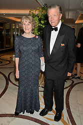 MICHAEL & LADY ANGELA OSWALD  at the 24th Cartier Racing Awards held at The Dorchester, Park Lane, London on 11th November 2014.