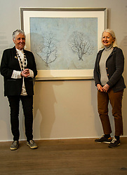 Pictured: Victoria Crowe OBE and Christine De Luca in front of Garden Full of Snow<br /><br />Another Time, Another Place at The Scottish Gallery - an exhibition of works by renowned artist Victoria Crowe OBE which have inspired 12 poems by poet Christine De Luca<br /><br />Ger Harley   EEm 29 April 2021