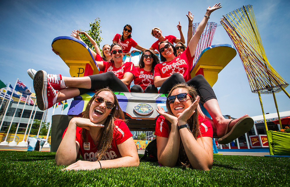 The Women's Water Polo team poses for a picture an a giant chair inside the Pan American Games athletes village in Toronto, Friday July 3, 2015.    THE CANADIAN PRESS/Mark Blinch
