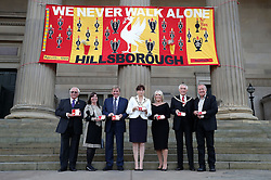 (Left to right) Trevor Hicks, Margaret Apsinall, Kenny Dalglish, the Lord Mayor of Liverpool Roz Gladden, Marina Dalglish, Consort Roy Gladden and Professor Phil Scraton all hold a medal for each of the 96 victims of the Hillsborough disaster at Liverpool Town Hall, which are to be given to families of the victims as they are awarded the Freedom of the City.