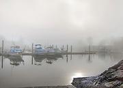 Foggy morning with sun peeping through at Milton Harbor in Rye, New york