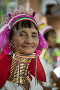 A long neck woman or Kayan people in a fabric store, in Inle Lake, Myanmar.<br /> Note: These images are not distributed or sold in Portugal
