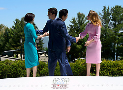 Japan Prime Minister Shinzo Abe, second right, and wife Akie Abe, left, are greeted by Prime Minister Justin Trudeau and wife Sophie Gregoire Trudeau during the official welcoming ceremony at the G7 Leaders Summit in La Malbaie, Quebec, Canada on Friday, June 8, 2018. Photo by Sean Kilpatrick/CP/ABACAPRESS.COM