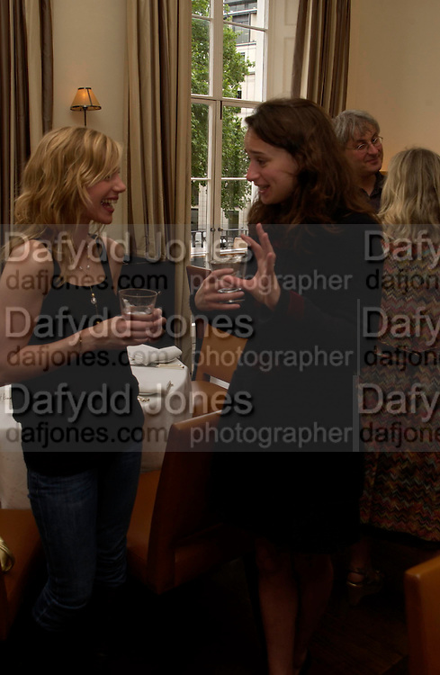 Ava Bergasol (?) and Angharad Wood.  Lunch party for Brooke Shields hosted by charles finch and Patrick Cox. Mortons. Berkeley Sq. 6 July 2005. ONE TIME USE ONLY - DO NOT ARCHIVE  © Copyright Photograph by Dafydd Jones 66 Stockwell Park Rd. London SW9 0DA Tel 020 7733 0108 www.dafjones.com