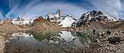 """Mount Fitz Roy (3405 m or 11,171 ft elevation) reflects in Laguna de Los Tres in Los Glaciares National Park, Santa Cruz Province, Argentina, Patagonia, South America. The trail called Sendero Fitz Roy leads from El Chalten to Laguna de Los Tres (20 km round trip with 1100 meters gain). Monte Fitz Roy is also known as Cerro Chaltén, Cerro Fitz Roy, or Mount Fitz Roy. The first Europeans recorded as seeing Cerro Fitz Roy were the Spanish explorer Antonio de Viedma and his companions, who in 1783 reached the shores of Viedma Lake. In 1877, Argentine explorer Francisco Moreno saw the mountain and named it Fitz Roy in honour of Robert FitzRoy who, as captain of HMS Beagle, had travelled up the Santa Cruz River in 1834 and charted large parts of the Patagonian coast. Mt Fitz Roy was first climbed in 1952. Cerro is a Spanish word meaning hill, while Chaltén comes from a Tehuelche word meaning """"smoking mountain"""", due to clouds that usually form around the peak.  Los Glaciares National Park and Reserve are honored on UNESCO's World Heritage List. This image was stitched from multiple overlapping photos."""