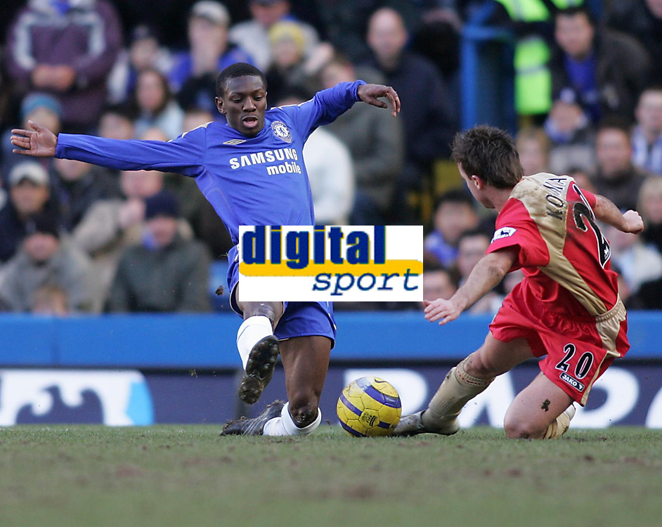 Photo: Lee Earle.<br /> Chelsea v Portsmouth. The Barclays Premiership. 25/02/2006. Chelsea's Shaun Wright-Phillips (L) clashes with Ognjen Koroman.