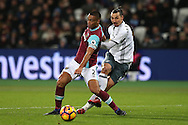 Zlatan Ibrahimovic of Manchester United takes a shot past Winston Reid of West Ham United. Premier league match, West Ham Utd v Manchester Utd at the London Stadium, Queen Elizabeth Olympic Park in London on Monday 2nd January 2017.<br /> pic by John Patrick Fletcher, Andrew Orchard sports photography.