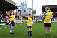 AFC Wimbledon foundation fan waving flag during the EFL Sky Bet League 1 match between AFC Wimbledon and Oldham Athletic at the Cherry Red Records Stadium, Kingston, England on 21 April 2018. Picture by Matthew Redman.
