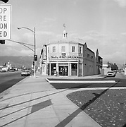 0609-105-11 Studio Cosmetics at the corner of W. Olive Avenue and Warner Blvd., about 1975