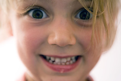 Portrait of little girl making a funny face,
