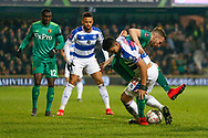 Queens Park Rangers midfielder Massimo Luongo (21) battles for possession with Watford midfielder Tom Cleverley (8) during The FA Cup 5th round match between Queens Park Rangers and Watford at the Loftus Road Stadium, London, England on 15 February 2019.