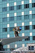 Alaska, Anchorage, man hard at work welding at a construction site.