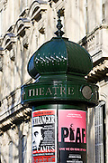 Obelisk advertising theatre productions of Edith Piaf and Camus in Parisian street, France