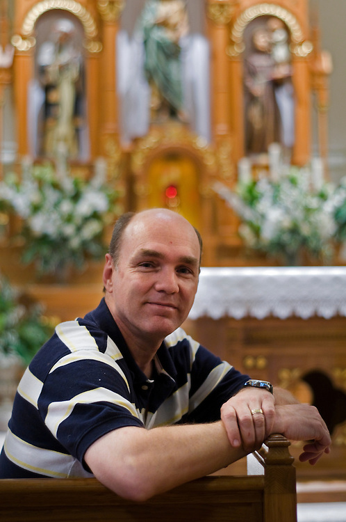 Russ Arnett poses for a portrait at St. John the baptist Church in Paris, Wisconsin where he is parish director, Tuesday, June 15. Arnett, a former Episcopal priest and now married, is in the process of studying for ordination as a Catholic priest.