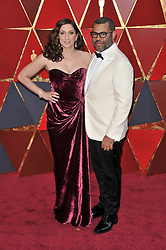 Chelsea Peretti and Jordan Peele walking on the red carpet during the 90th Academy Awards ceremony, presented by the Academy of Motion Picture Arts and Sciences, held at the Dolby Theatre in Hollywood, California on March 4, 2018. (Photo by Sthanlee Mirador/Sipa USA)