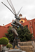 A statue honoring the traditional Concheros also known as the El Danzante Conchero in the old colonial section of Santiago de Queretaro, Queretaro State, Mexico.